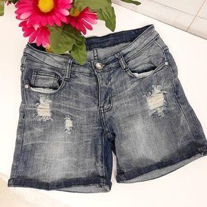 Machine distressed jean shorts